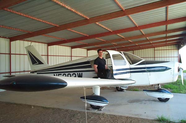 dennis maust frames mike with his piper cherokee in the hangar